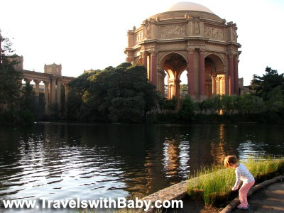 A young child enjoys the Palace of Fine Arts in San Francisco www.travelswithbaby.com