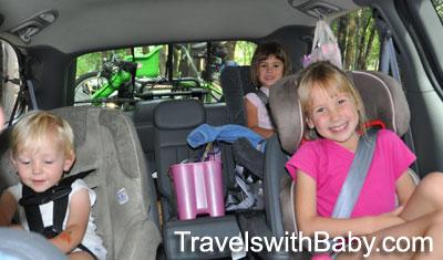 Rivoli family travelers road-tripping in the family van