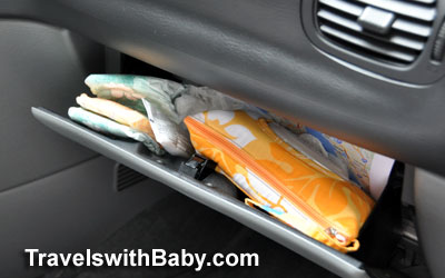 Use your glovebox for quick-access storage of diapers and travel-size wipes for front seat diaper changes.