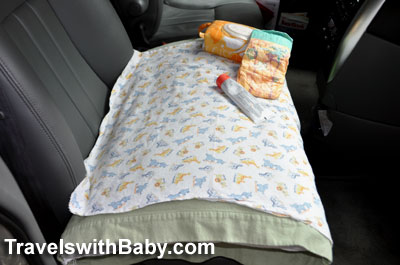 Use a firm bed pillow to help even out bucket seats for diaper changes during road trips with your baby.