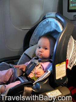 baby flying rear-facing in car seat on airplane