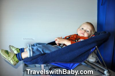 Toddler flying in British Airways Britax seat - TravelswithBaby.com