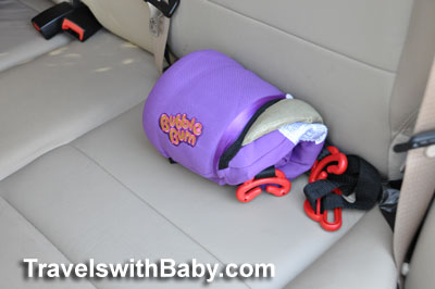 The Bubble Bum shown deflated and rolled in comparison with the car's seat.