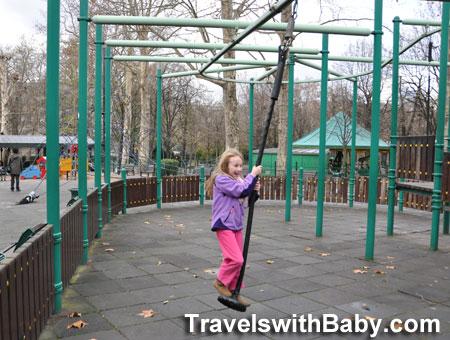 kid ziplining at park