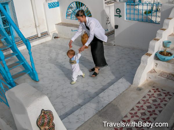 At Sidi Bou Said: Learning to walk on a rooftop in Tunisia.