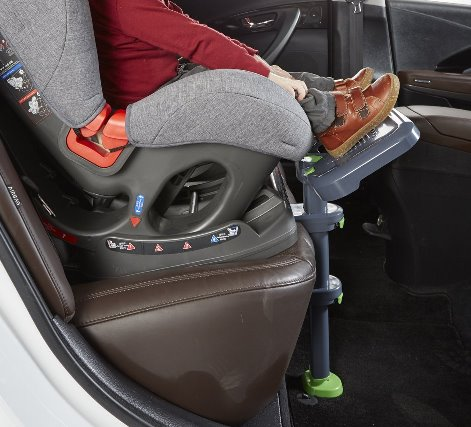 The KneeGuard car seat foorest helps from when feet first reach over the forward-facing car seat.